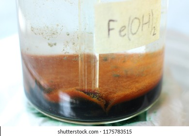 The precipitate of iron hydroxide precipitated on the bottom of the beaker which oxidized to brown iron hydroxide.