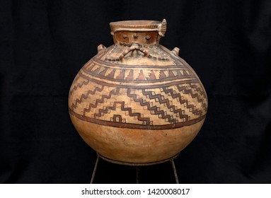 """Pre-columbian animal-shaped ceramic called """"Huaco"""" from unidentified ancient Peruvian culture. Pre inca handcrafted pottery piece made by ancient civilization."""
