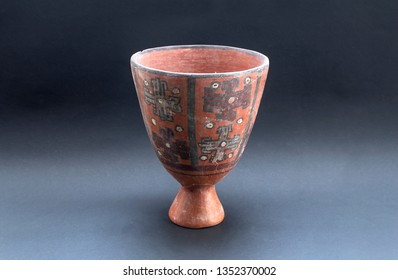 """Pre-columbian ceramic vase called """"Huaco"""" from Nazca, an ancient Peruvian culture. Pre inca handcrafted pottery vessel piece made by this ancient civilization."""