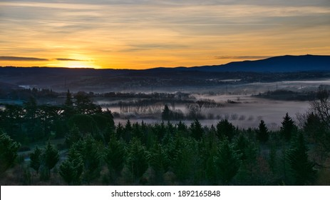Pre-dawn landscape with low clouds in the valleys