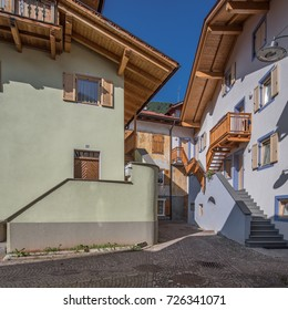Predazzo village, Fiemme valley, Dolomites, Italy-August 20, 2017: Stylish, decorated, colorful and renovated houses in the village, Trento, Trentino, South Tyrol