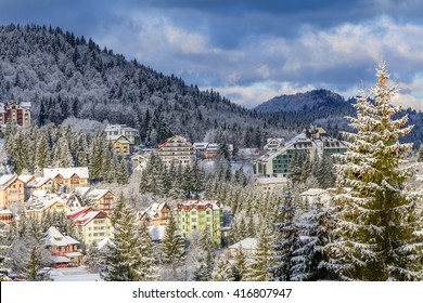 Predeal, Romania - March 14: Panoramic view on March 14, 2016 in Predeal, Romania. Winter in Carphatian Mountains, Romania. Scenery with frozen buildings in wintertime, mountains, evening shades