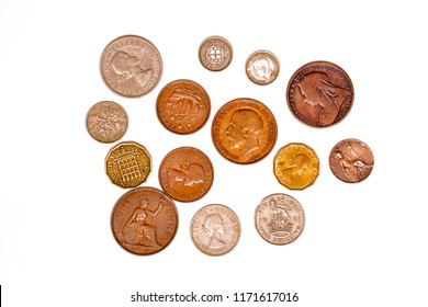 Pre-decimal UK coins solated on a white background