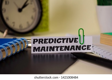 Predictive Maintenance on the paper isolated on it desk. Business and inspiration concept