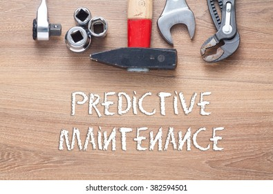 Predictive Maintenance words - Conceptual,set of tools on wood background top view