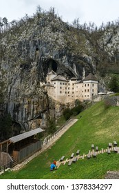 Predjama Castle, situated in the middle of a cliff near Postojna Cave, is the largest cave castle in the world