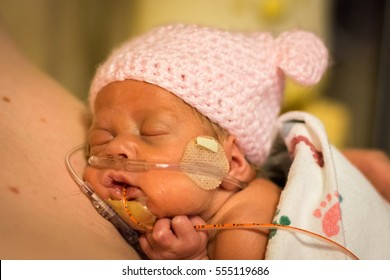 Preemie baby girl gets some skin to skin with her dad in the nicu