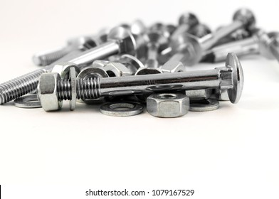 Prefabricated metal screw for fastening on the background of bolts, nuts and washers.