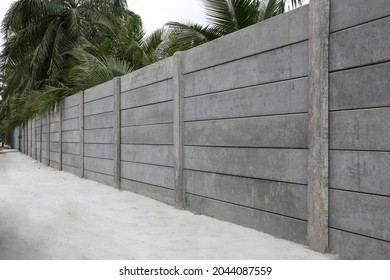 Prefabricated or precast concrete fence. Consist of panel and column as border or boundary offer security, privacy for residential. Including empty space on road floor paving with concrete pavement.