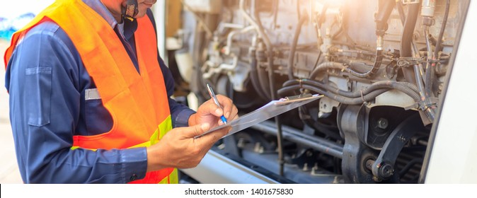 Preforming a pre-trip inspection on a truck,Concept preventive maintenance truck checklist,Check truck engine,Check the lubricating oil,spot focus.