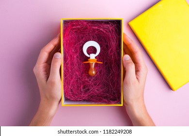 Pregnancy concept. The nipple lies in the gift box. Planning pregnancy, future motherhood. Planning to become a parent, expecting a baby