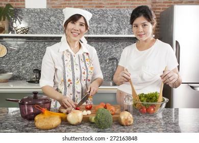 pregnancy cook, a pregnancy tummy woman cooking fresh salad