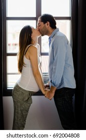 Pregnancy, lovely couple at home