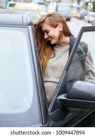 Pregnant beautiful young woman with car outdoor. Pregnant smiling pretty woman in standing near car. pregnancy and car.
