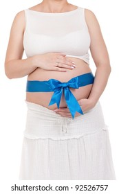 Pregnant belly with blue ribbon - isolated over a white background. Third trimester.