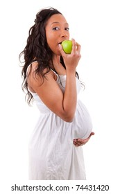 pregnant black woman eating an apple