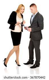 Pregnant businesswoman talking with her partner