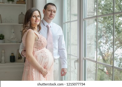 Pregnant couple. Man bonding his pregnant woman