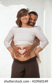 pregnant couple in a well lit room