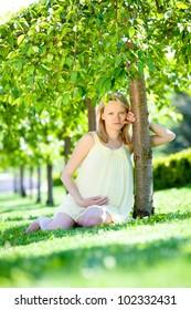 Pregnant female in park