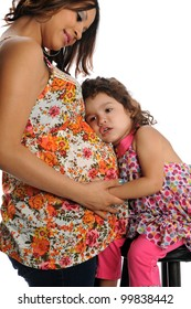 Pregnant Hispanic mother with daughter embracing isolated over white background