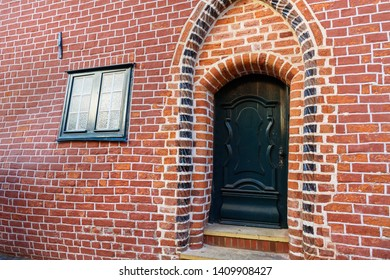 Pregnant house or Das Schwangere Haus with deformed brick wall in Luneburg. Germany