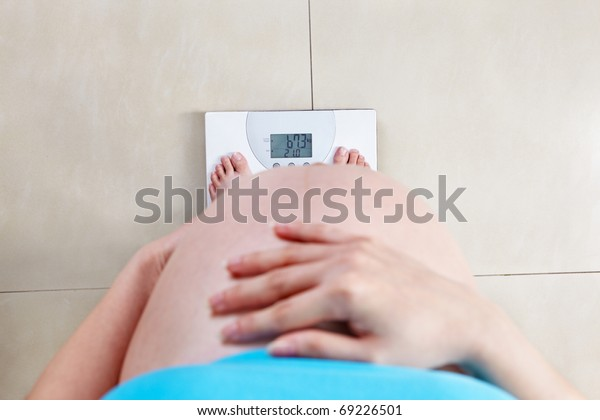 Pregnant Lady Measuring Her Weight Taken Stock Photo (Edit