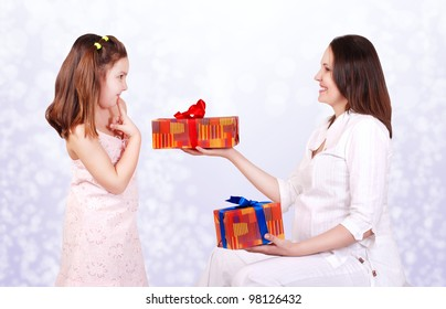 Pregnant mother prepare gifts for her daughter. Brother or sister?