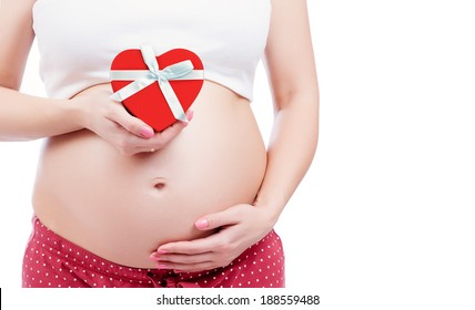 Pregnant mother showing her belly and holding a gift