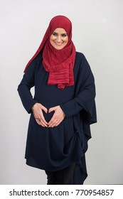 A pregnant Muslim woman covered with a scarf