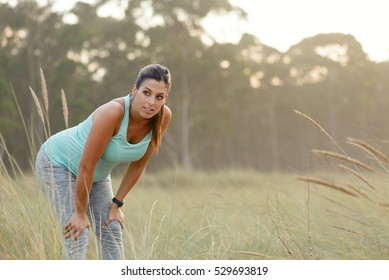 Pregnant sporty woman taking a fitness workout rest. Healthy pregnancy active lifestyle outdoor.