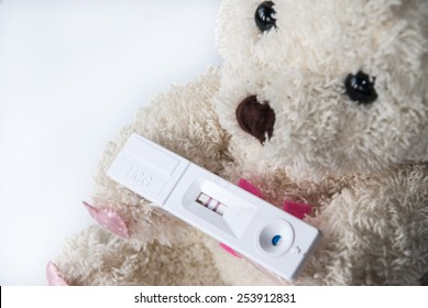 Pregnant test of teen sad