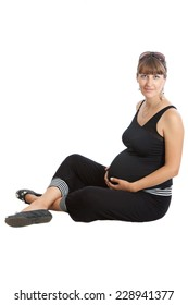A pregnant woman, 9 months, sitting