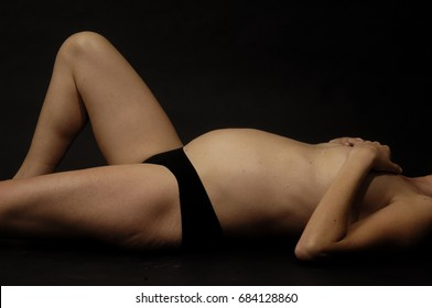 pregnant woman with black background