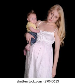 Pregnant woman carrying baby looking exasperated and tired