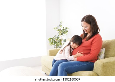 Pregnant Woman and child