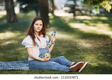 Pregnant woman choosing healthy food and water. Pregnancy diet, nutrition, healthy lifestyle, intrauterine growth, maternity, motherhood concept