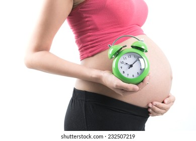 Pregnant woman with clock