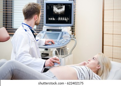 Pregnant woman at the doctor. Ultrasound diagnostic machine. ultrasound transducer woman pregnant doctor prenatal care clinic concept