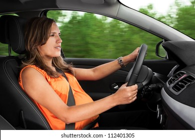 Pregnant Woman Driving Car Through the Woods