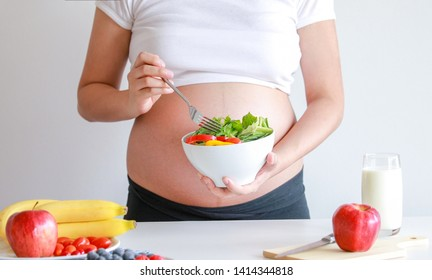 pregnant woman eat vegetable salad and fruit, healthy food
