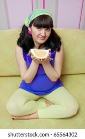 pregnant woman eating fruits at home