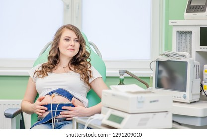 Pregnant woman with electrocardiograph check up for her baby.