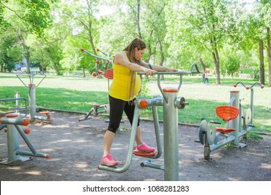 Pregnant Woman Fitness Outdoors Park