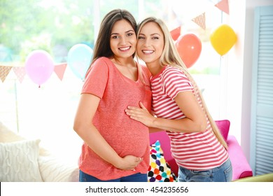 Pregnant woman and friend at baby shower party
