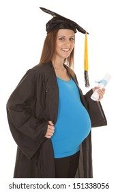 A pregnant woman with a graduation gown on.