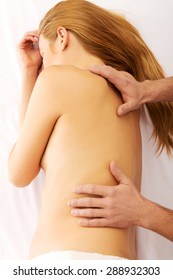 Pregnant woman having a massage on her back
