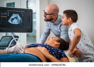 Pregnant woman and her family on utltrasonographic examination at hospital