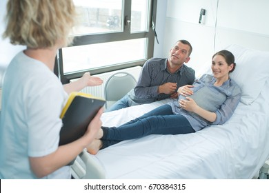 pregnant woman and her man in delivery room