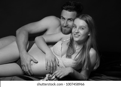Pregnant woman and her man  studio black and white photography